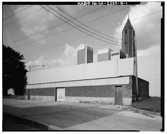 1.  WEST FRONT AND SOUTH SIDE. - Techwood Homes, Garage Building A-D, Corner of Merrit Avenue & Williams Street, Atlanta, Fulton County, GA