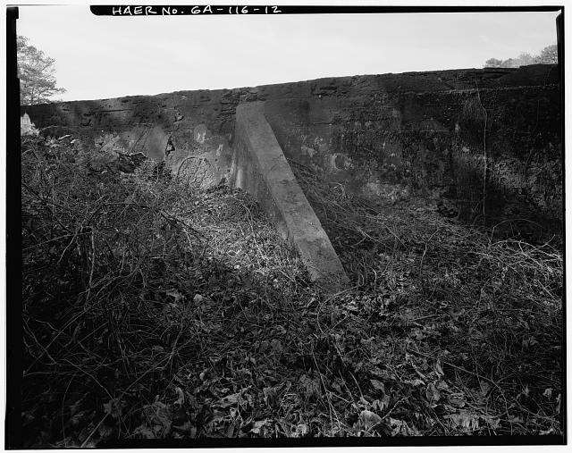 12.  DETAIL VIEW OF LARGE BUTTRESS AT SOUTH ABUTMENT, LOOKING WEST-SOUTHWEST - Big Lake Dam, Fourth Street, South of Atlantic Avenue, Marietta, Cobb County, GA