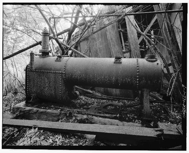 9.  RW Meyer Sugar Mill: 1876-1889. Locomotive-type, fire-tube, portable boiler, No. 1 model. Manufactured by Ames Iron Works, Oswego, New York, 1879. 120 lbs/sq. inch working pressure, 66 sq. ft. heating surface in tubes. View: from side. The boiler provided steam for steam engine which in turn powered the mill's centrifugals. The section on the left side included the firebox with its surrounding water-legs. The fluted chimney-type structure is the steam port, safety valve, and whistle. Column projecting from side was part of steam pressure and water gauge. Pipe running above boiler carried steam to the engine. Pipe running below boiler provided the boiler feed-water. Cylindrical section included 22 fire-tube surrounded by water. The far right ... - R. W. Meyer Sugar Mill, State Route 47, Kualapuu, Maui County, HI