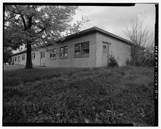 4.  ADMINISTRATION BUILDING, FRONT AND RIGHT SIDES, LOOKING SOUTHWEST. - NIKE Missile Base C-84, Administration Building, North of Launch Area Entrance Drive, Barrington, Cook County, IL