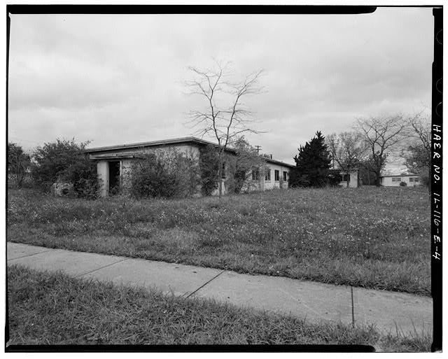 4.  BARRACKS, SHORTER BUILDING, FRONT AND LEFT SIDES, LOOKING NORTHWEST. - NIKE Missile Base C-84, Shorter Barracks, South of Launch Area Entrance Drive, west of Longer Barracks, Barrington, Cook County, IL