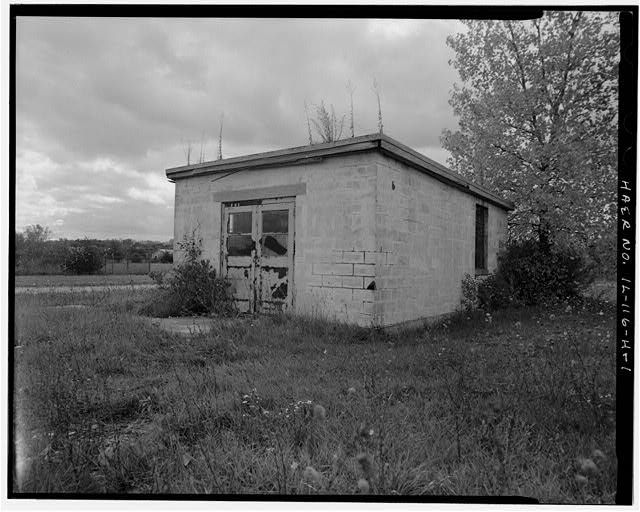 1.  PUMP HOUSE, FRONT AND RIGHT SIDES, LOOKING SOUTHWEST. - NIKE Missile Base C-84, Pump House, North of Launch Area Entrance Drive, southwest of Missile Assembly Area, Barrington, Cook County, IL