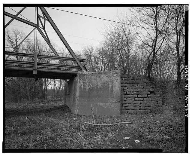 7.  VIEW NORTH, LOOKING AT CONCRETE/STONE MASONRY ABUTMENTS AND SOUTHEAST BEARING - Kidner Bridge, Spanning Mississinewa River at County Road 700 South, Upland, Grant County, IN
