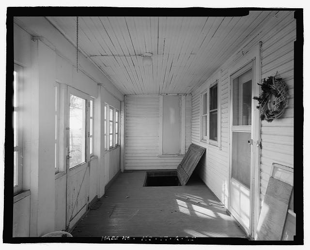 25.  Interior view of residence, east porch, looking south with trap door to cellar open - George Spangerberger Farmstead, Residence, 2012 West Illinois Avenue, South Hutchinson, Reno County, KS