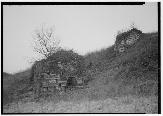 1.  REMAINS OF FURNACE STACK LOOKING NW, ABUTMENT FOR LOADING FURNACE IN BACKGROUND. - Hunnewell Iron Furnace, Junction of State Routes 2 & 1773, Hunnewell, Greenup County, KY