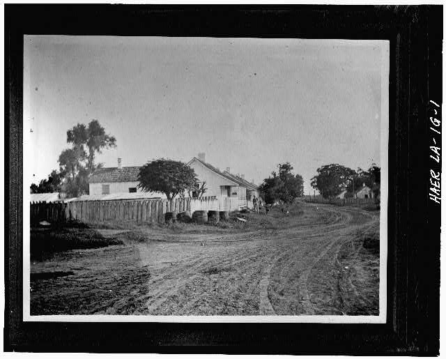 1.  Photocopy of c. 1906 photograph of row Creole T houses across from mill pond that were available to skilled workers including engineers. - Laurel Valley Sugar Plantation, Engineer's House, 2 Miles South of Thibodaux on State Route 308, Thibodaux, Lafourche Parish, LA