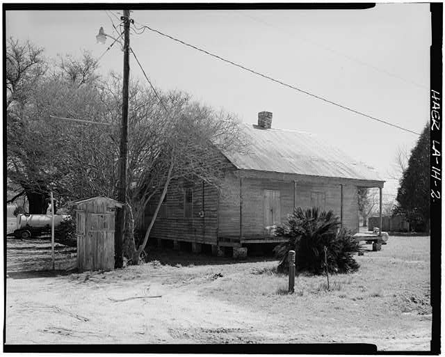 2.  3/4 view of front and side elevations. - Laurel Valley Sugar Plantation, Double Creole Quarters, 2 Miles South of Thibodaux on State Route 308, Thibodaux, Lafourche Parish, LA