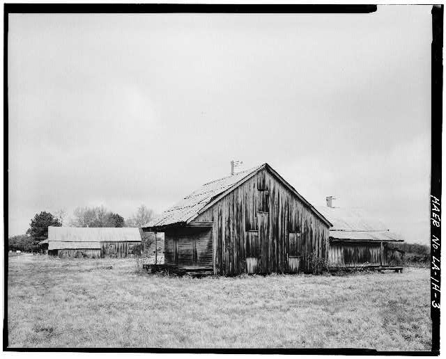 3.  View of Double Creole 'T' house with general store appearing in background, looking W. - Laurel Valley Sugar Plantation, Double Creole Quarters, 2 Miles South of Thibodaux on State Route 308, Thibodaux, Lafourche Parish, LA