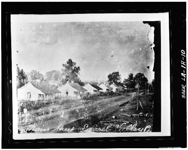 10.  Photocopy of c. 1906 photograph looking SE at row of double Creole quarters along Main Street. - Laurel Valley Sugar Plantation, Double Creole Quarters, 2 Miles South of Thibodaux on State Route 308, Thibodaux, Lafourche Parish, LA