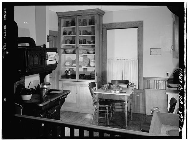 12.  FIRST FLOOR, KITCHEN, VIEW OF STOVE, CHINA CABINET AND TABLE, VIEW TAKEN FROM REAR HALLWAY - John Fitzgerald Kennedy Birthplace, 83 Beals Street, Brookline, Norfolk County, MA