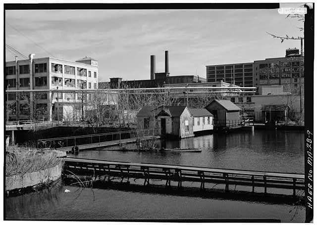 9.  SWAMP LOCKS VIEWED FROM ACROSS THE ENTRANCE TO THE MERRIMACK CANAL, LOOKING SOUTHEAST: 1976 - Pawtucket Canal, Swamp Locks, Pawtucket & Merrimack Canals, Lowell, Middlesex County, MA