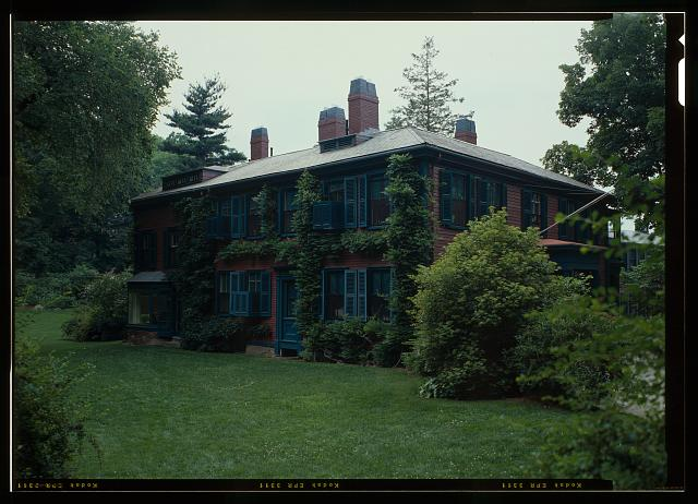 64.  PERSPECTIVE VIEW OF THE SOUTH ELEVATION OF THE HOUSE.  VIEW INCLUDES THE WISTERIA AND ACTINIDEA VINES GROWING ON THE REMOVABLE TRELLIS SYSTEM.  (DUPLICATE OF HABS No. ma-1168-30) - Fairsted, 99 Warren Street, Brookline, Norfolk County, MA