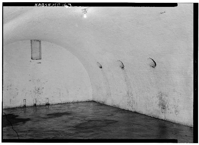 32.  July 1958 END WALL OF SOUTHERNMOST LARGE CASEMATE. NOTE VENTILATOR HOLES AT RIGHT, AND REMNANT OF FIREPLACE CENTERED ON END WALL. - Fort McHenry National Monument & Historic Shrine, East Fort Avenue at Whetstone Point, Baltimore, Independent City, MD
