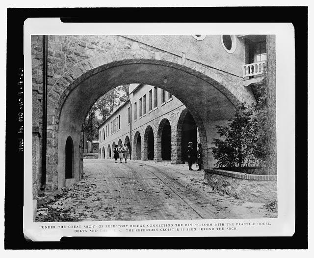 Copy image of &quot;&#39;Under the Great Arch&#39; of Refectory Bridge connecting the Dining Room with the Practice House, Delta, and the Villa. The Refectory Cloister is seen beyond the arch&quot;; a similar, but recent, view can be seen in MD-1109-A-16. (NPS view book, p. 25) - National Park Seminary, Main, Linden Lane, Silver Spring, Montgomery County, MD
