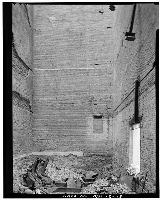 18.  GRAIN-ELEVATOR SECTION, INTERIOR, LOOKING EAST FROM WEST END; SOUTH LOADING DOOR VISIBLE IN LOWER RIGHT - Crown Roller Mill, 105 Fifth Avenue, South, West Side Milling District, Minneapolis, Hennepin County, MN