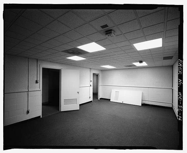 14.  Readiness Crew Building interior, large bedroom, lower hall. Thalheimer - Whiteman Air Force Base, Bomber Alert Facility S-6, 1300 Alert Road, Knob Noster, Johnson County, MO
