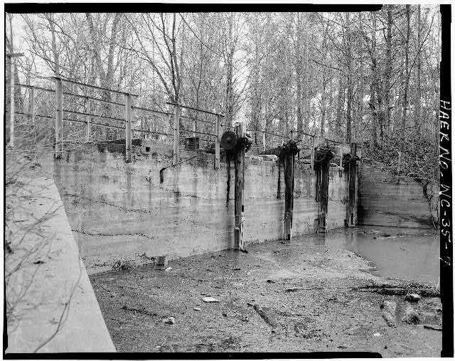 7.  VIEW OF SLUICE GATE AT DAM - Lockville Hydroelectric Plant, Deep River, 3.5 miles upstream from Haw River, Moncure, Chatham County, NC