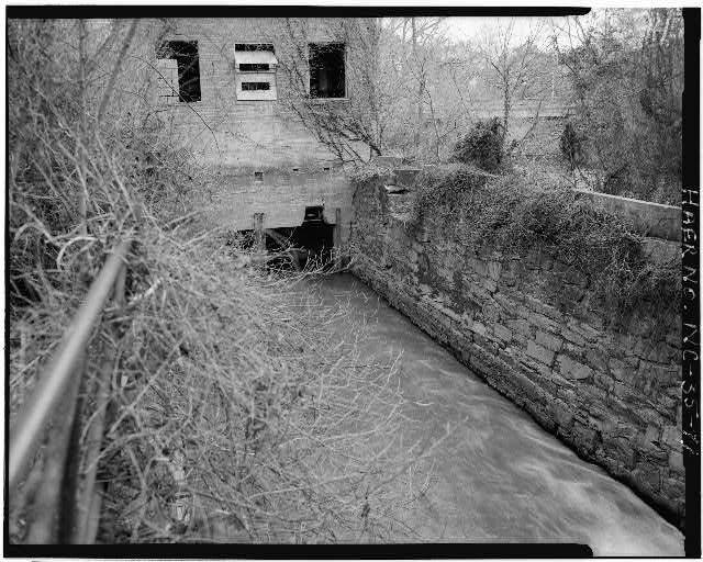 11.  VIEW OF WEST ELEVATION OF POWERHOUSE, LOOKING EASTWARD ALONG CANAL - Lockville Hydroelectric Plant, Deep River, 3.5 miles upstream from Haw River, Moncure, Chatham County, NC
