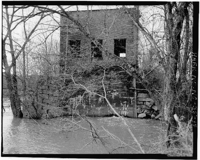 14.  VIEW SHOWING EAST ELEVATION OF POWERHOUSE FROM NORTH BANK OF THE DEEP RIVER - Lockville Hydroelectric Plant, Deep River, 3.5 miles upstream from Haw River, Moncure, Chatham County, NC