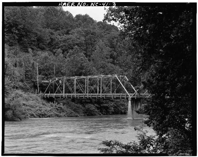 3.  VIEW OF BRIDGE, FROM SOUTHEAST, SHOWING PRATT PORTION - North Carolina Route 1314 Bridge, Spanning Toe River, Relief, Mitchell County, NC