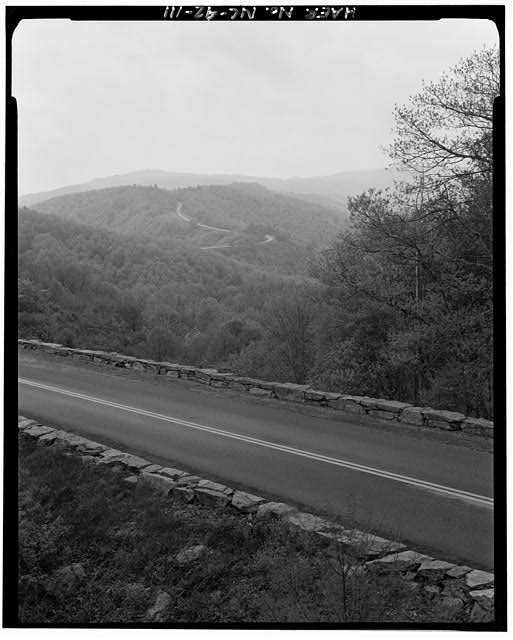 111.  Doughton Park Recreation Area. View of parkway with the road crossing alligator back. Facing southeast. - Blue Ridge Parkway, Between Shenandoah National Park & Great Smoky Mountains, Asheville, Buncombe County, NC