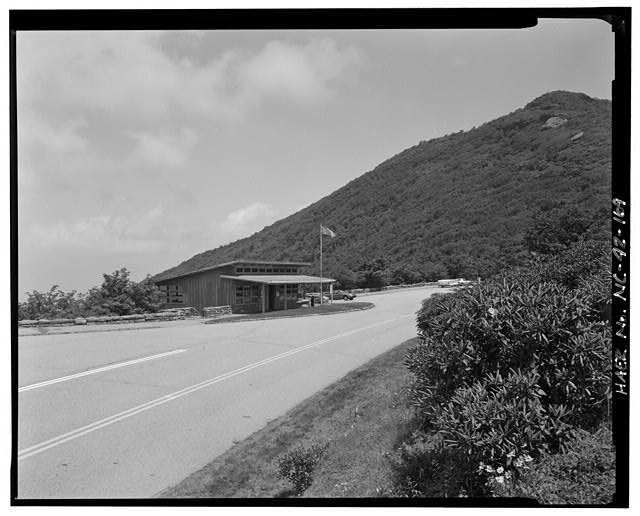 169.  View of the Craggy Gardens Visitor Center, opened in 1952, Craggy Gardens overlook and Craggy Pinnacle in the background to the north. - Blue Ridge Parkway, Between Shenandoah National Park & Great Smoky Mountains, Asheville, Buncombe County, NC