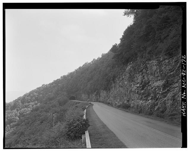 172.  View of the Craggy Flats Tunnel with a guardrail and road cut visible in the foreground. Facing south. - Blue Ridge Parkway, Between Shenandoah National Park & Great Smoky Mountains, Asheville, Buncombe County, NC