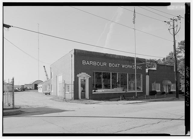10.  Exterior view of showroom and offices and view through entry gate to Main Yard. - Barbour Boat Works, Tryon Palace Drive, New Bern, Craven County, NC