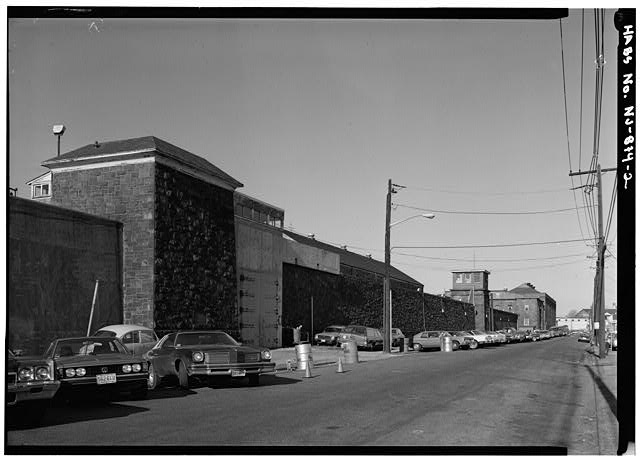 2.  OBLIQUE VIEW OF PRISON WALL FROM EAST DOWN THIRD STREET; FRONT HOUSE (ADMINISTRATION BUILDING) IS IN BACKGROUND - New Jersey State Prison, Second & Federal Streets, Trenton, Mercer County, NJ