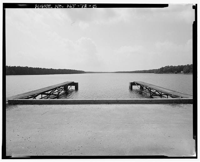 5.  VIEW FROM TOP OF DAM ABOVE SPILLWAY LOOKING WESTERLY TO NORTHWESTERLY ACROSS RESERVOIR. TWO WATER INTAKE STRUCTURES AND FOOT BRIDGES IN FOREGROUND - Upper Doughty Dam, 200 feet west of Garden State Parkway, 1.7 miles west of Absecon, Egg Harbor City, Atlantic County, NJ