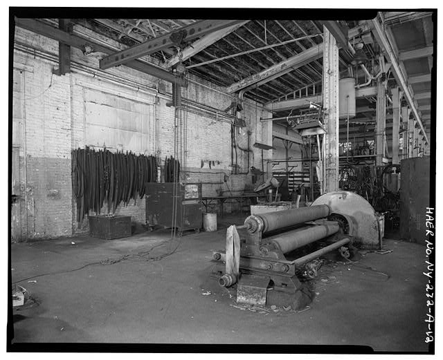 12.  SOUTH BAY SHOWING 5/8 X 8 PYRAMID PLATE BENDING ROLLS, JIB CRANE, SWEEPS (L). VIEW SOUTHWEST - Oldman Boiler Works, Boilershop, 32 Illinois Street, Buffalo, Erie County, NY