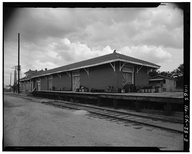 3.  EXTERIOR, CLOSE-UP OF WEST SIDE AND NORTH FRONT SHOWING FREIGHT DEPOT IN FOREGROUND - St. Louis, San Francisco Railroad Station, Perry, Noble County, OK