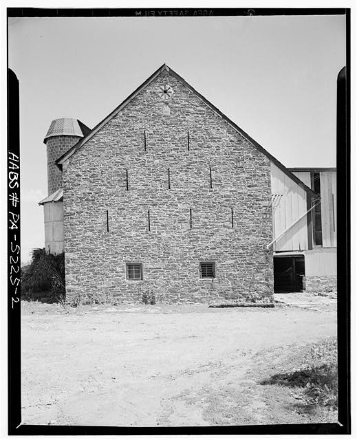 2.  DETAIL OF STONE END WITH SLIT VENTILATORS. ALSO NOTE DATE STONE AND BRICK EIGHT-POINT DESIGN - Jacob E. Long Barn, County Road, Lancaster, Lancaster County, PA
