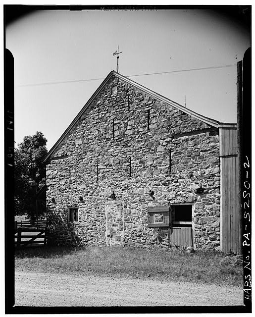 2.  SLOTTED SIDE ELEVATION. DATE STONE READS CASIAN AND CATHERINE MAUL 1791. - Maul Stone Barn (1791), (Oley Township), General Lesher's grave vicinity, Oley, Berks County, PA