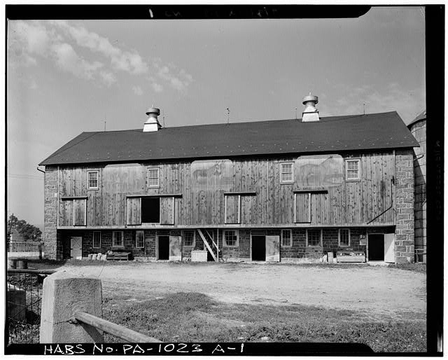 1.  GENERAL VIEW. OVERHANG, PAINTED RED, HAS VERTICAL SIDING AND FADED PAINTINGS OF FARM ANIMALS: COW, DONKEYS AND HORSE. - De Turck House, Barn, State Route 662 vicinity, Oley Township, Oley, Berks County, PA
