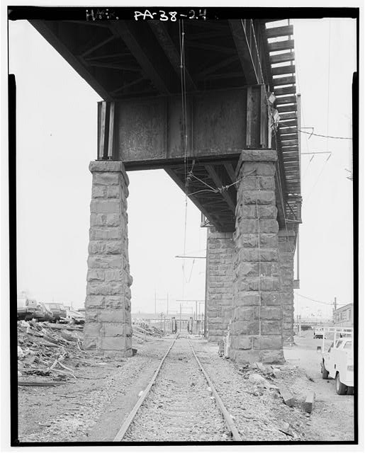 24.  FROM 30th STREET COACH YARDS, PIERS ALLOW TRACK TO PASS UNDER. - Pennsylvania Railroad, West Philadelphia Elevated, Parallel to Schuylkill River, north of Arsenal Bridge, Philadelphia, Philadelphia County, PA