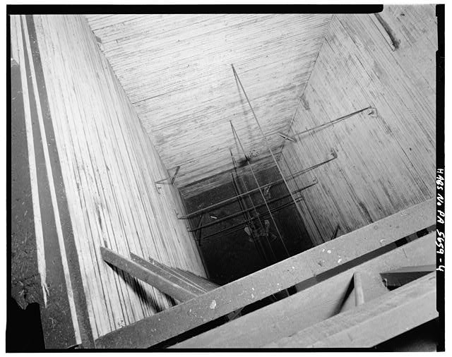 4.  INTERIOR, VIEW INTO HOPPER FROM FIFTH LEVEL - A. & H.S. Overholt Company Distillery, Frick Avenue, West Overton, Westmoreland County, PA