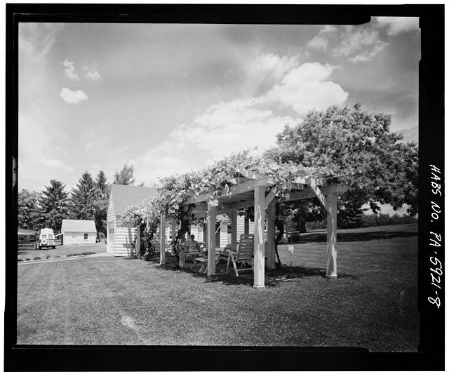 8.  VIEW OF ORIGINAL HOMESTEADER MARY WOLK IN HER ARBOR, NEXT TO GARAGE, EAST LAUREL CIRCLE AT LILAC DRIVE, SECTION B - Town of Norvelt, Norvelt, Westmoreland County, PA