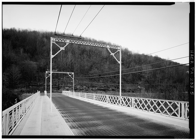 5.  VIEW OF NORTH END OF BRIDGE ROADWAY LOOKING NORTH - Fifficktown Bridge, Spanning Little Conemaugh River, South Fork, Cambria County, PA