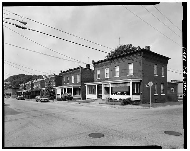 6.  301-23 SOUTH SIXTH STREET, 6 DOUBLE HOUSE UNITS, PERSPECTIVE VIEW OF EAST (FRONT) AND NORTH, LOOKING SOUTHEAST - Western Land & Improvement Company Double Houses, South Fifth & Sixth Streets, Jeannette, Westmoreland County, PA