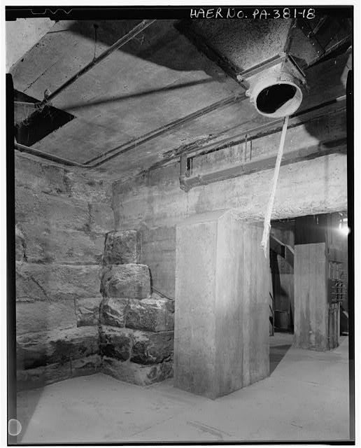 Basement of 1913 elevator looking west into 1945 elevator and indicating incorporation of railroad retaining wall as the elevator's basement wall - Stewart Company Grain Elevator, 16 West Carson Street, Pittsburgh, Allegheny County, PA