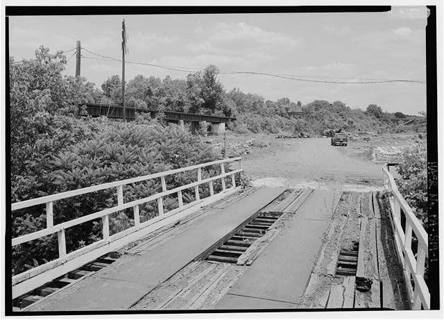 View looking Eastnortheast at French Creek trestle, which appears at left center of frame.  Bridge in foreground is west entrance to abandoned Phoenix iron works. - Pennsylvania Railroad, French Creek Trestle, Spanning French Creek, north of Paradise Street, Phoenixville, Chester County, PA