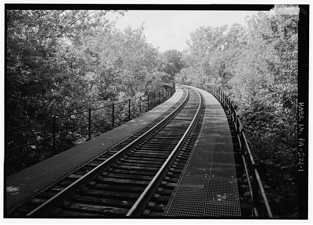 Longitudinal view at track level, looking due north. - Pennsylvania Railroad, Pickering Creek Trestle, Spanning Pickering Creek, south of Buckwalter Road, Pickering, Chester County, PA