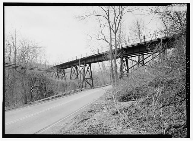 Perspective view of trestle, looking south along road. - Pennsylvania Railroad, Pickering Creek Trestle, Spanning Pickering Creek, south of Buckwalter Road, Pickering, Chester County, PA