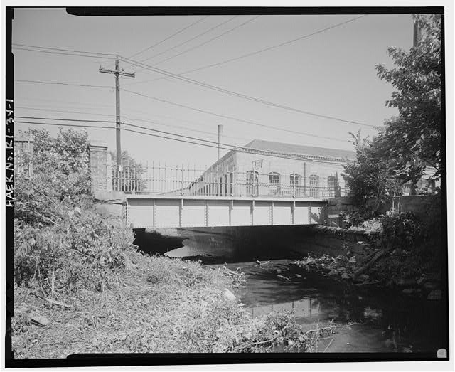 1.  VIEW LOOKING SOUTHEAST TOWARD BRIDGE, FORMER SILVER SPRING BLEACHING AND DYEING COMPANY MILL IN BACKGROUND. - Charles Street Bridge, Spanning West River on Charles Street, Providence, Providence County, RI