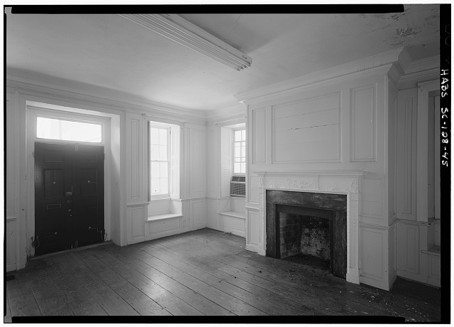 45.  INTERIOR VIEW OF FIRST FLOOR, SOUTHWEST ROOM, (FRONT) ENTRANCE ALONG SOUTH WALL AND FIREPLACE ALONG WEST WALL - Daniel Blake Tenement, 6-8 (2-4) Courthouse Square, Charleston, Charleston County, SC