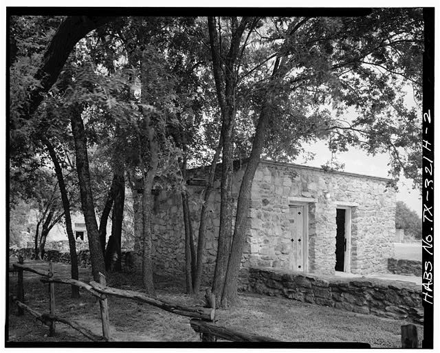 2.  EAST (FRONT) AND SOUTH SIDES, LOOKING NORTHEAST. - Mission San Juan de Capistrano, Outhouse, Berg's Mill-Graf Road, San Antonio, Bexar County, TX