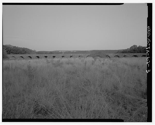 ELEVATION FROM NW. - Possum Kingdom Stone Arch Bridge, Spanning Brazos River at State Route 16, Graford, Palo Pinto County, TX