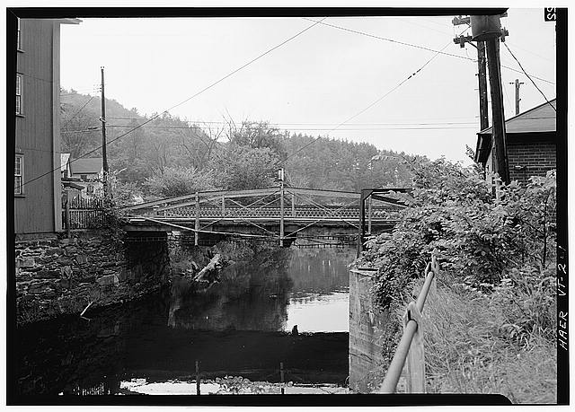 1.  Iron Bridge carrying main road across river. - Mount Vernon Street Bridge, Sleepers River, Saint Johnsbury, Caledonia County, VT