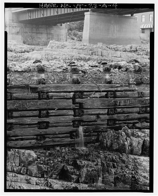 4.  DETAIL OF DOWNSTREAM FACE, SHOWING MOST INTACT SECTION OF TIMBERS, VIEW NORTHEAST - Burlington Woolen Mill Company, Dam, Winooski River, West of Bridge carrying U.S. Route 2&7, Burlington, Chittenden County, VT